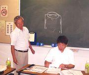 講師を務める横山支部長(左)